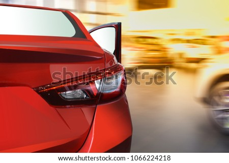 Fast car on street blurry background.For automotive or transportation image. #1066224218