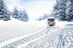 fast car on winter road and snow splash