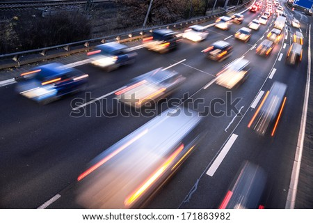 fast cars on highway in evening ...