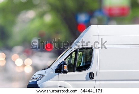 Fast delivery, van on city street blured bokeh background