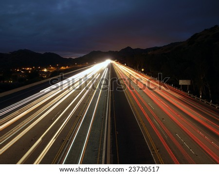 Fast evening traffic on a ten lane California Freeway.
