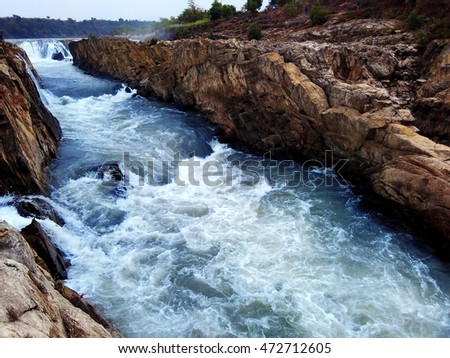 Fast flowing Narmada river nature beauty at Dhuadhar waterfall, Jabalpur, India  #472712605