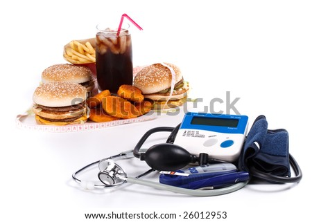 Fast-food, blood pressure meter, stethoscope and glucose meter on a white background