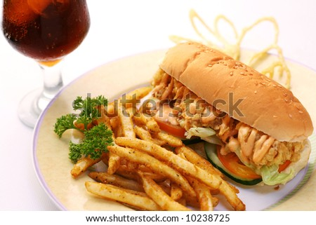 fast food crispy chicken sandwich served with crispy french fries and soda - stock photo