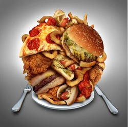 Fast food diet concept served on a plate of greasy fried take out as onion rings burger and hot dogs with fried chicken french fries and pizza as a symbol of compulsive overeating and dieting.