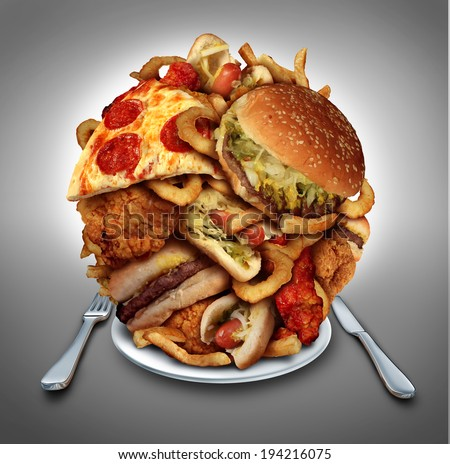Fast food diet concept served on a plate of greasy fried take out as onion rings burger and hot dogs with fried chicken french fries and pizza as a symbol of compulsive overeating and dieting. Foto d'archivio ©