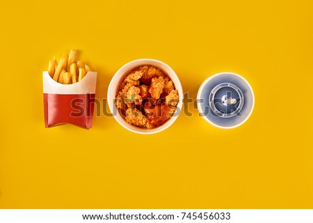 Fast food dish on yellow background. Fast food set fried chicken and french fries. Take away fast food. #745456033