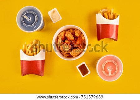 Fast food dish on yellow background. Fast food set fried chicken and french fries. Take away fast food. #751579639