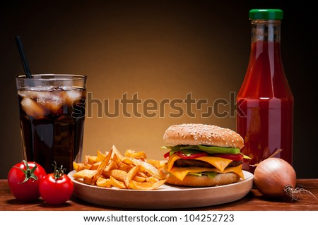 fast food hamburger menu with burger, french fries, cola and ketchup