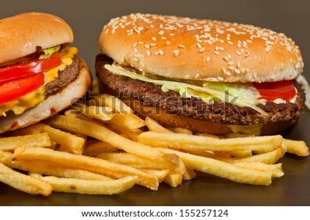 fast food set big hamburger and french fries on black background
