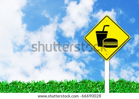 fast food sign on beautiful sky and grass field background