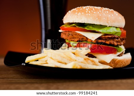 Fast food tasty hamburger  with french fries and soda
