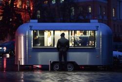 fast food trailer in night street