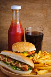 Fast food with burger, hot dog, french fries, tomato ketchup and cola