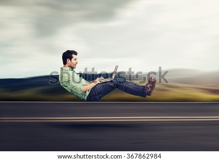 Fast internet concept. Autonomous self driving vehicle car technology. Levitating business man on road using laptop #367862984