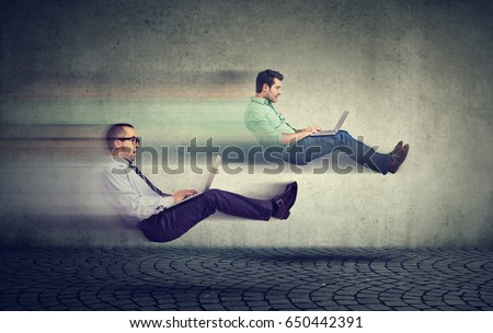Fast internet concept. Two levitating business men on road using laptop #650442391