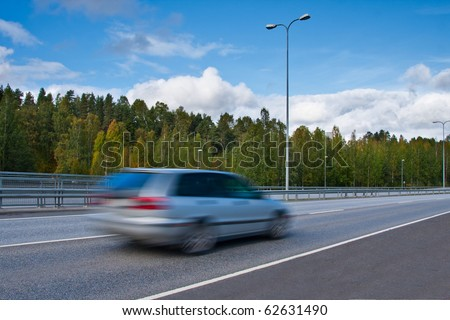 Fast moving car on highway