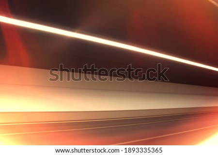 Fast moving light in tunnel. Dynamic and Abstract background with black space created in camera with lines of red and white spectrums of light crossing to achieve a sense of movement. Stock Photo. stock photo