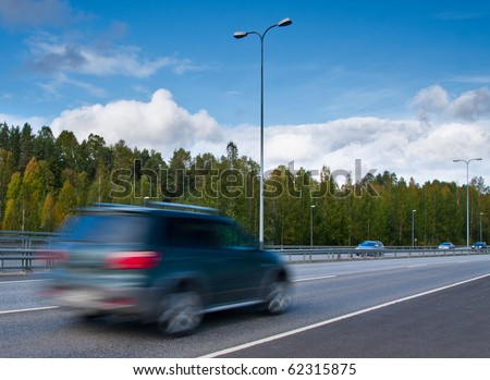 fast moving SUV car on highway