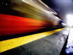 Fast passing train motion blur on foggy night, New York