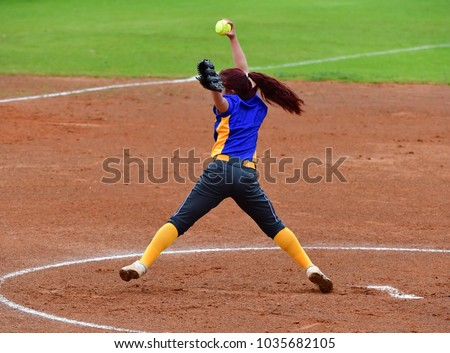 Fast Pitch Softball Pitcher Throwing For a Strike