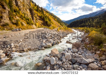 Fast powerful mountain river in the autumn in the mountains of Georgia.