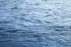 Fast river water background with waves and ripple pattern