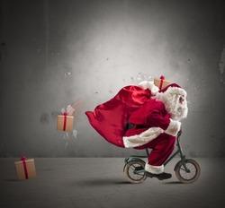 Fast Santa Claus on a small bike