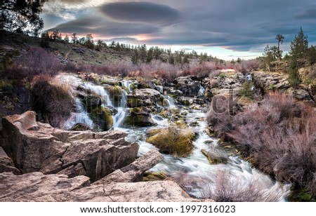 Fast stream in the valley. River stream view. River stream landscape. River stream in valley
