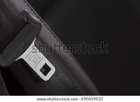 Shutterstock Fasten seat belt. A macro shot of a brand new seatbelt isolated on black. The belt is composed to the left. Copy space. Since 1959 text on the metal