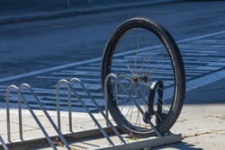 Fastened bicycle wheel. Stealing bicycles on the street. Wheel Of Stolen Bicycle