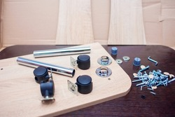 Fasteners for collecting furniture. A set of fasteners for assembling the table. Screws and furniture components, furniture wheels
