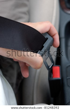 Fastening the seatbelt in the car.
