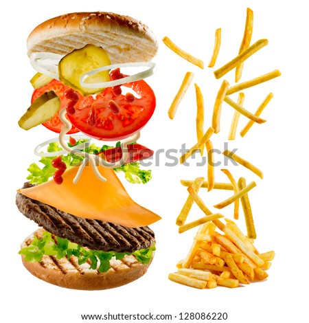 Fastfood - hamburger and french fries - flying fried potatoes and flying ingredients of hamburger