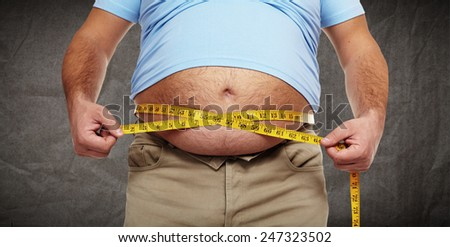 Fat belly. Man with overweight abdomen. Weight loss concept.