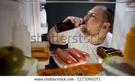 Fat man drinking beer with pleasure from fridge at night, unhealthy lifestyle #1271086291