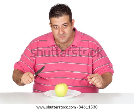 Fat man eating a apple isolated on white background