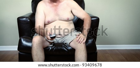 Fat man holding a remote while watching tv