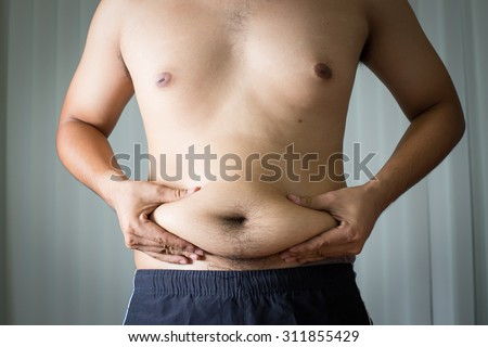 Fat man in house with gray background