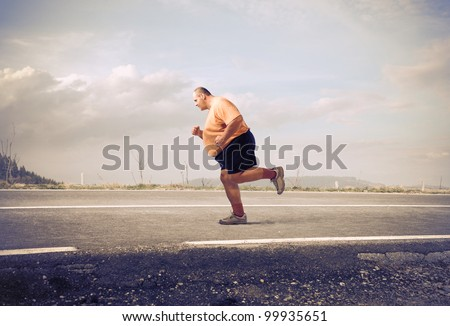 Fat man jogging on a country road