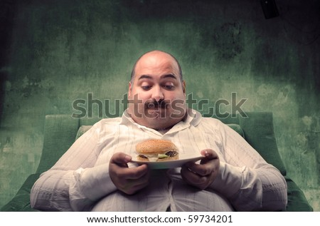 fat person in bikini. stock photo : Fat man sitting