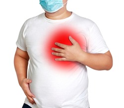 Fat man wearing a mask Put your hand on your chest with trouble breathing Are at risk of developing diabetes Hypertension Coronary heart disease Hyperlipidemia Coronavirus danger condition.