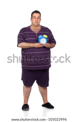 Fat man with a blue alarm clock isolated on white background