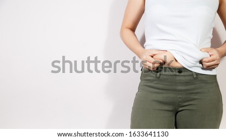 Fat woman, Fat girl, Fat belly, Chubby, Overweight fatty belly of woman isolated on white background, Woman diet lifestyle concept to reduce belly and shape up healthy stomach muscle.