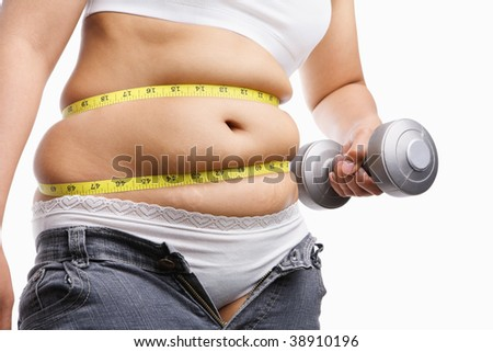fat woman holding weight to exercise with measuring tape around her belly, a concept to fight obesity