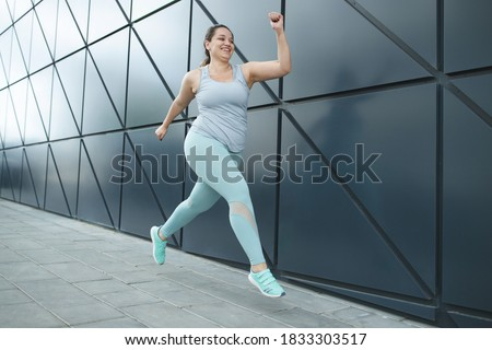 Fat woman jogging, doing sports for weight loss, obesity problem. High quality photo. Photo stock ©