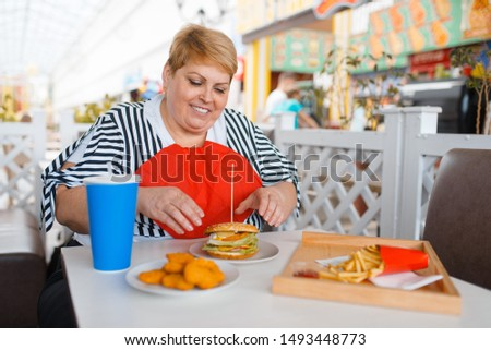 Fat woman prepares to eats fastfood