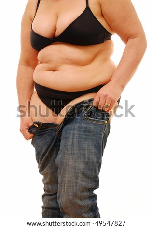 Fat woman struggling to put on jeans