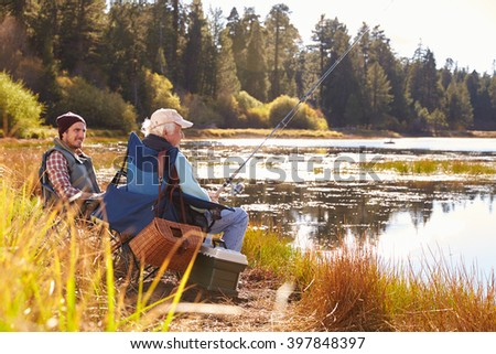 Father and adult son fishing lakeside, Big Bear, California