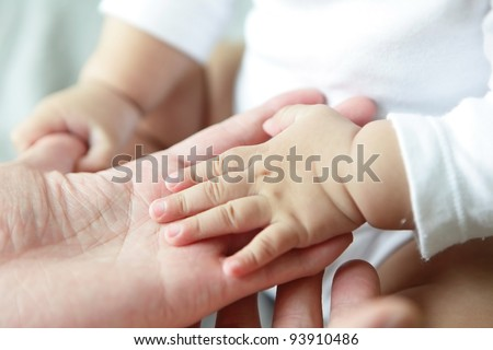 Father and Baby Hand Closeup